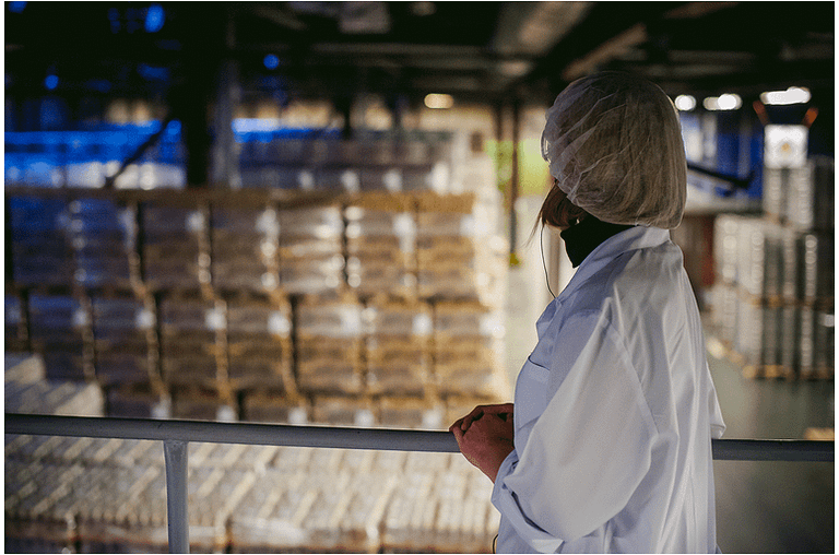 Woman employee looking over warehouse 2